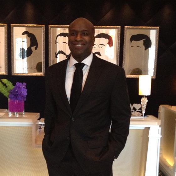 Tory Dandy wearing a black suit