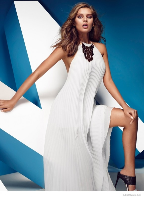 A white Guess by Marciano maxi dress with a halter top