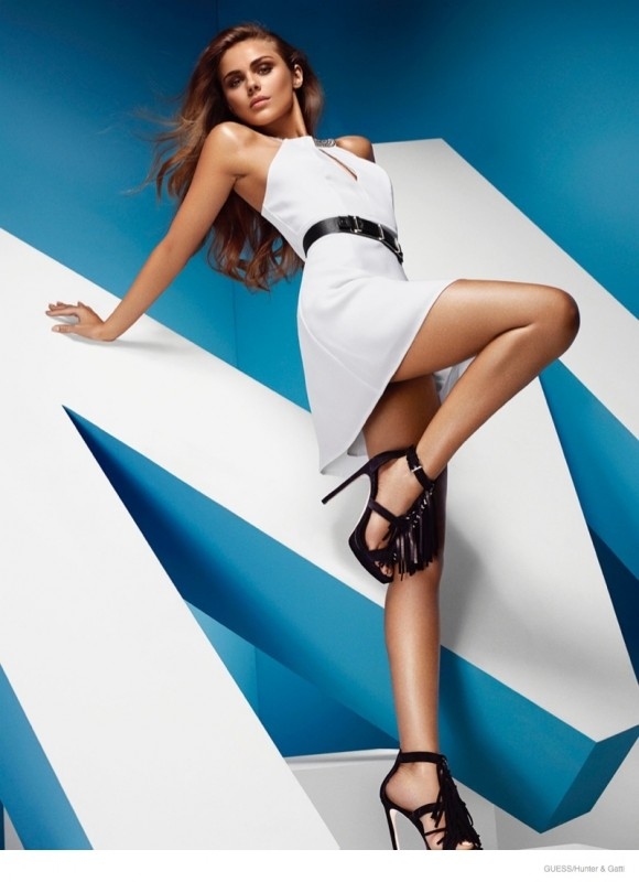 A white dress, black belt and platform heels make quite the statement