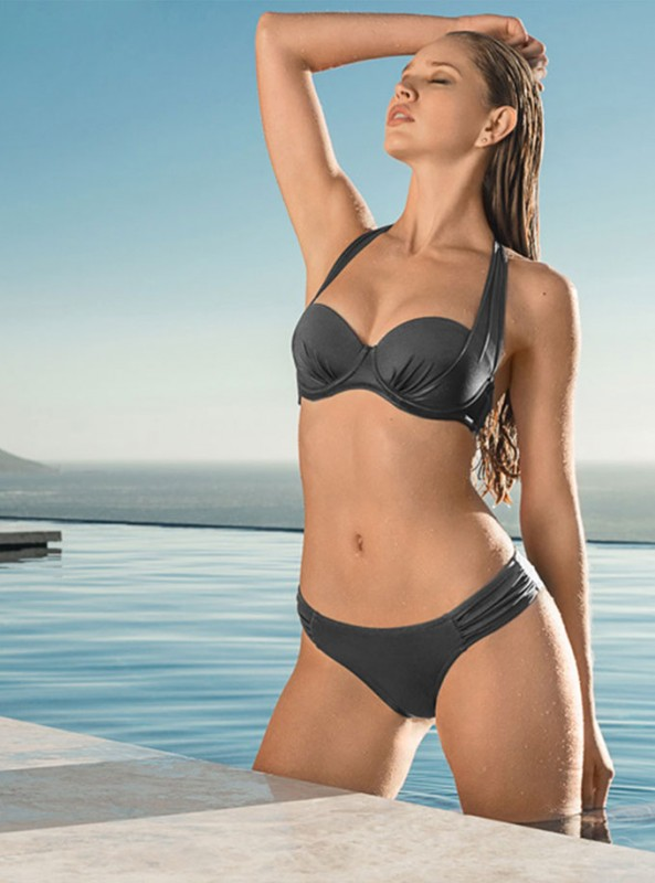 Stroll alongside the mediterranean sea in this 2 in 1 sling bikini top. In a luxe pewter grey, this underwired style with moulded cups give your assets great lift and shape and the ruching under the bust creates a flattering fit. Wear the side sling ties as either a halter neck or tie behind for a strapless style.