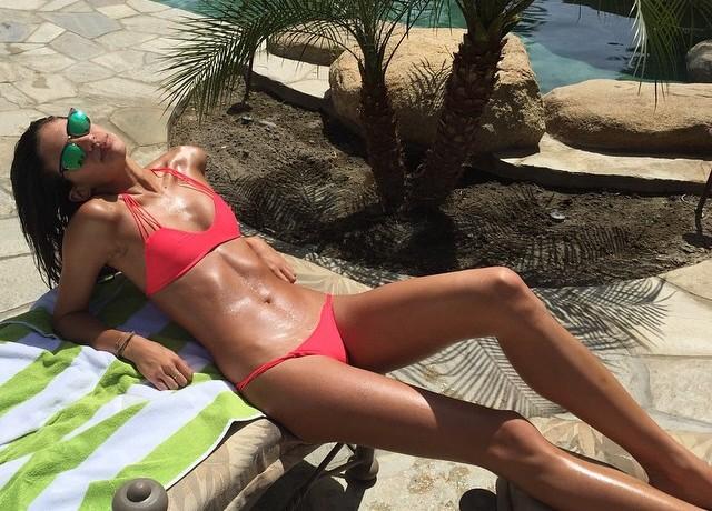 Sara Sampaio rocks a hot pink swimsuit at Coachella weekend