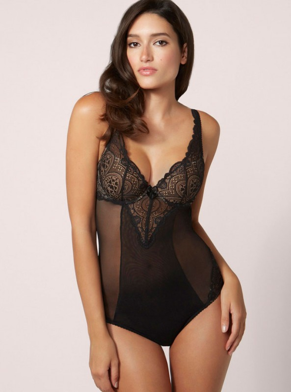 This sultry black mesh thong body is one our favourites. We love the two tone nude and exotic black lace detail that whispers subtle seduction. The striking v-front lace panel and peek-a-boo back with bow embellishment make this style all the more alluring.