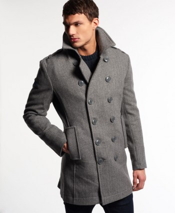 Superdry men's Bridge coat. This wool rich coat features a Superdry logo patch under the collar, a button fastening, two front pockets and a single inner pocket. The Bridge coat is finished with a metal Superdry logo badge on the sleeve.