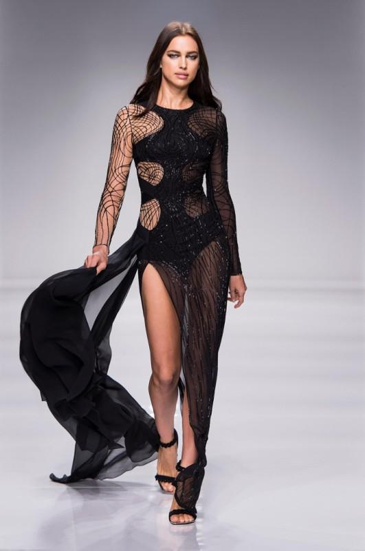 Irina Shayk walks Atelier Versace's spring 2016 show wearing a black gown