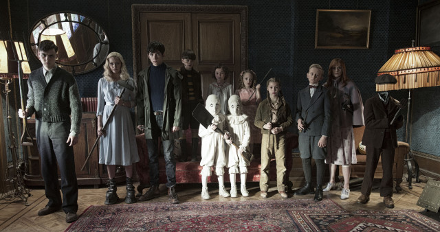 The residents of MISS PEREGRINE'S HOME FOR PECULIAR CHILDREN ready themselves for an epic battle against powerful and dark forces. Left to right: Enoch (Finlay Macmillan), Emma (Ella Purnell), Jake (Asa Butterfield), Hugh (Milo Parker), Bronwyn (Pixie Davies), the twins (Thomas and Joseph Odwell), Claire (Raffiella Chapman), Fiona (Georgia Pemberton), Horace (Hayden Keeler-Stone), Olive (Lauren McCrostie), and Millard (Cameron King). Photo Credit: Jay Maidment.