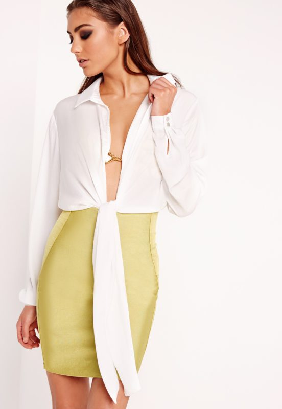 enhance your curves and flaunt your sexy bod' in our peace + love bodysuit! in a classic clean white finish, luxe shirt design with draping tie detailing to the front creating a gorg' plunging style. with popper finish to the gusset, the easy to throw on piece is perfect for upping your style game! team up with our premium bandage midi skirt and heels for a jaw to the floor look!