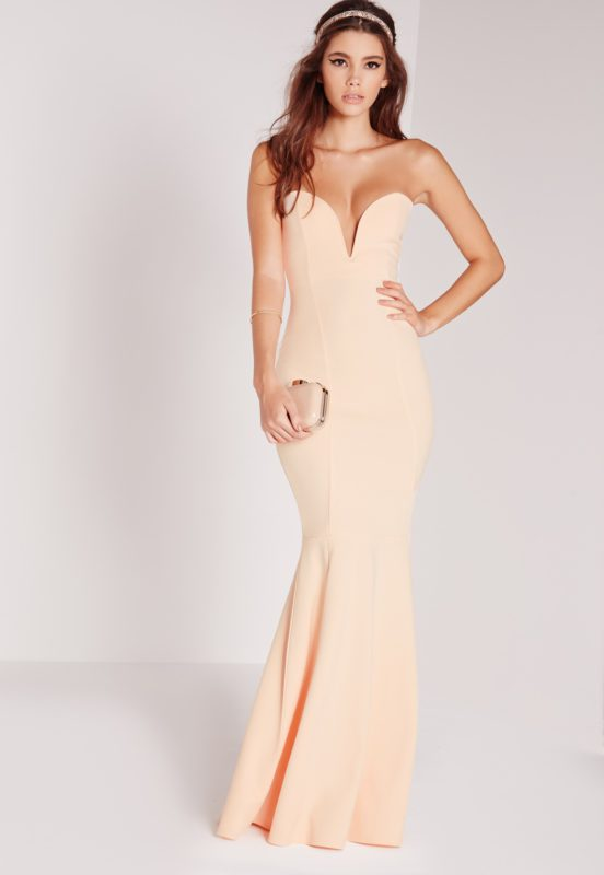 look ultimately flawless in this maxi dress. in a sexy shade of nude, bandeau style and a fishtail finish, you'll be looking smokingly elegant. style with barely there heels and a delicate clutch for all round evening vibes. make sure this is your go-to occasion dress!