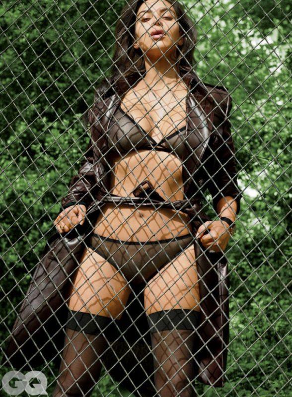 Kim Kardashian flaunts plenty of skin behind a fence