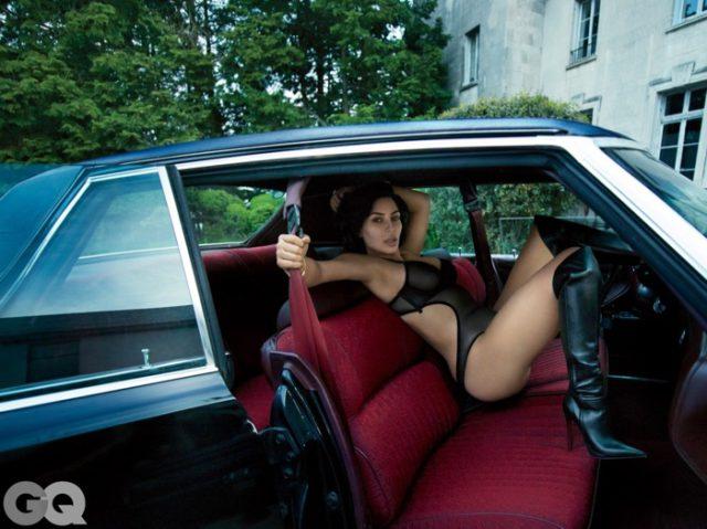 Kim Kardashian poses in a car wearing La Perla bodysuit with Christian Louboutin boots