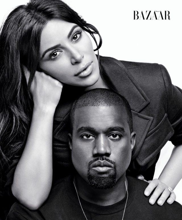 Kim Kardashian poses with husband Kanye West in Prada jacket