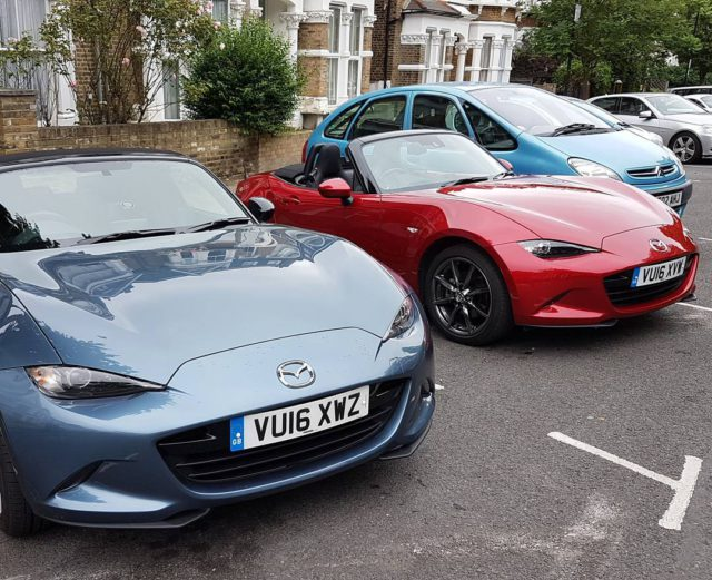 mazda mx5 in red and blue