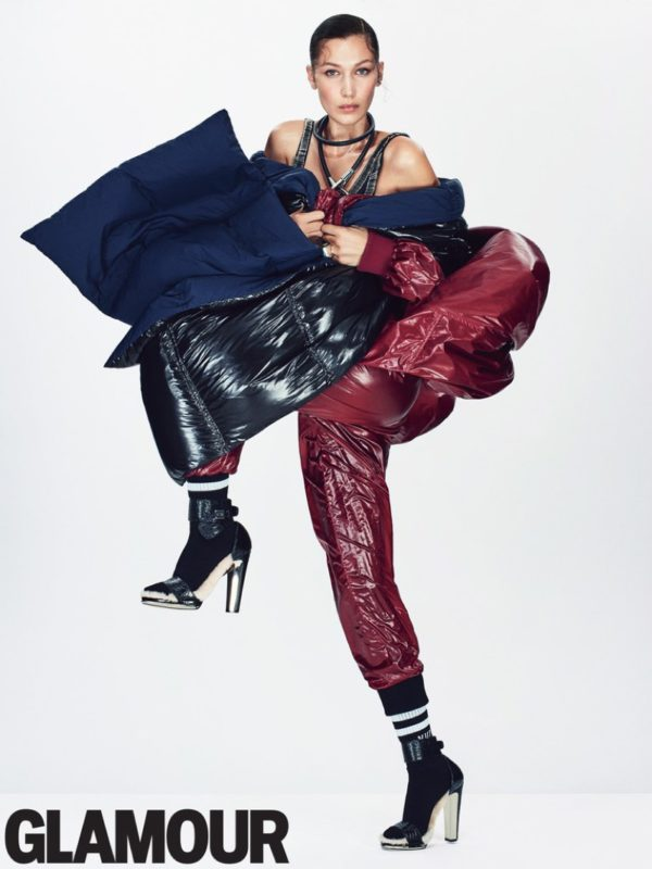 Bella Hadid layers up in DKNY coat, pants, puffer and scarf with Norma Kamali swimsuit