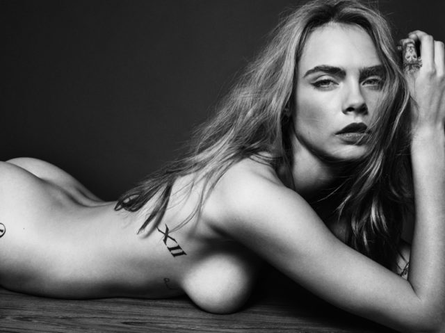 Cara Delevingne poses naked in this black and white photo