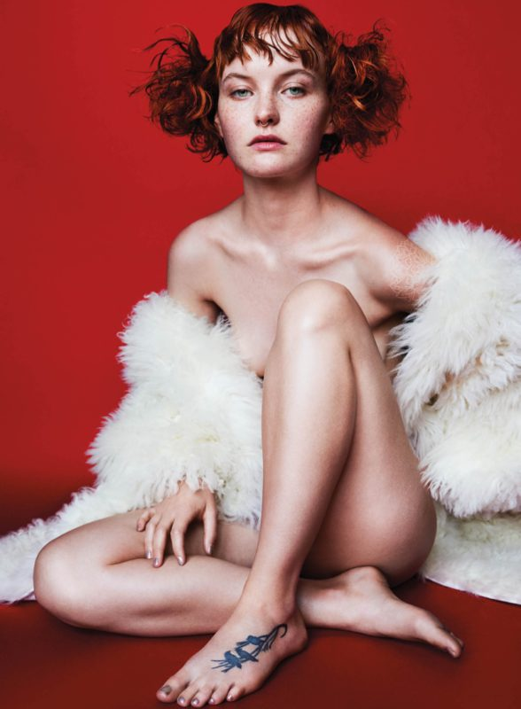 Kacy Hill strips down in white Chloe coat