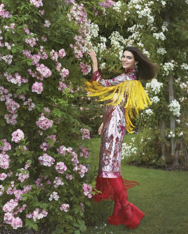 Posing in a garden, Kendall Jenner is all smiles wearing Gucci sequin embellished dress and boots