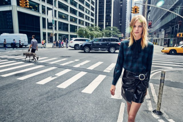 Lexi Boling wears plaid shirt and faux leather skirt from Mango