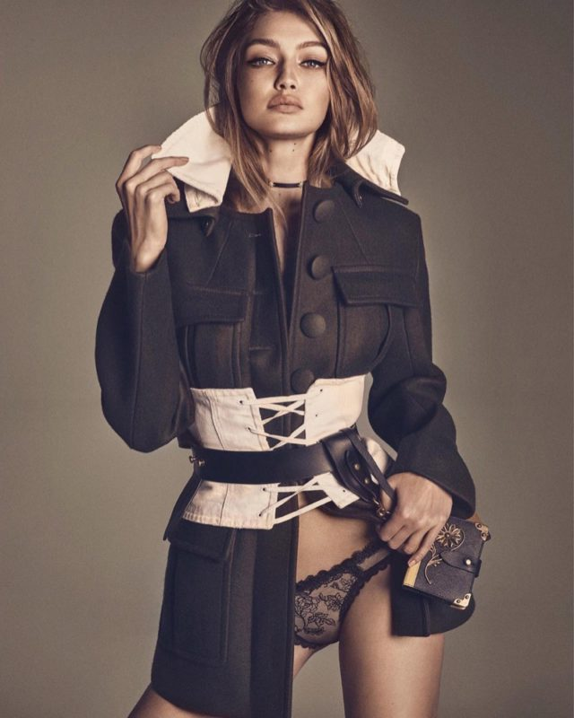 model-gigi-hadid-wears-prada-utility-jacket-with-corset-and-bag