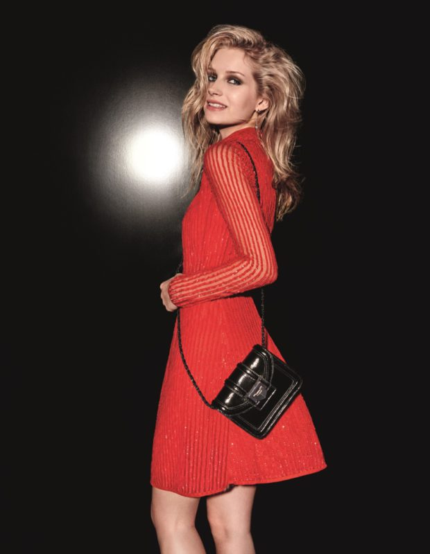 Be the 'girl in the red dress' and add this iconic  beaded piece to your repetiore. As worn here  by Lottie Moss, it works best paired with chic  accessories and sexy, undone hair.
