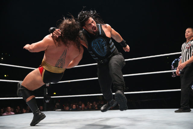 Roman Reigns rocks Rusev with a thunderous clothesline.