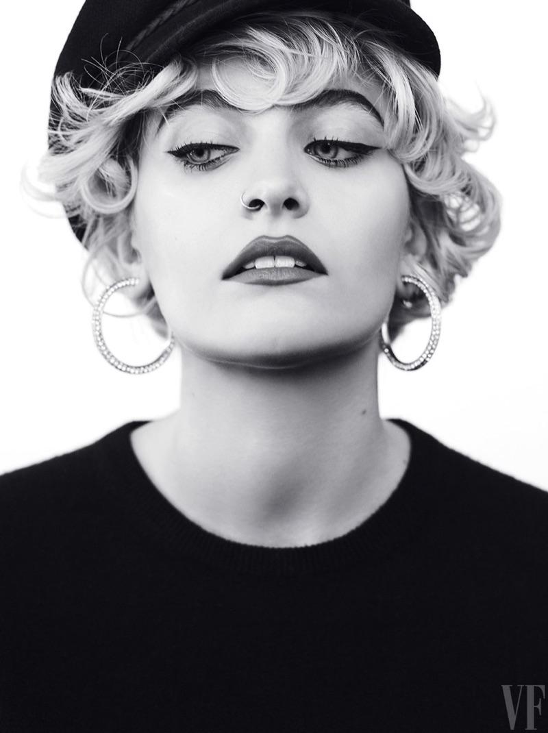 Getting her closeup, Paris Jackson wears hoop earrings and knit top