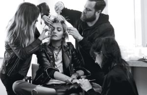 Surrounded by a glam squad, Paris Jackson rocks a leather jacket and ripped denim
