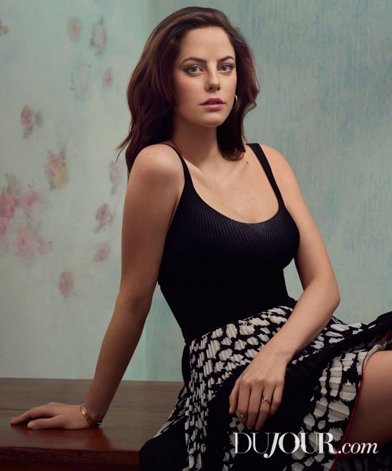 Actress Kaya Scodelario poses in black tank top with printed skirt