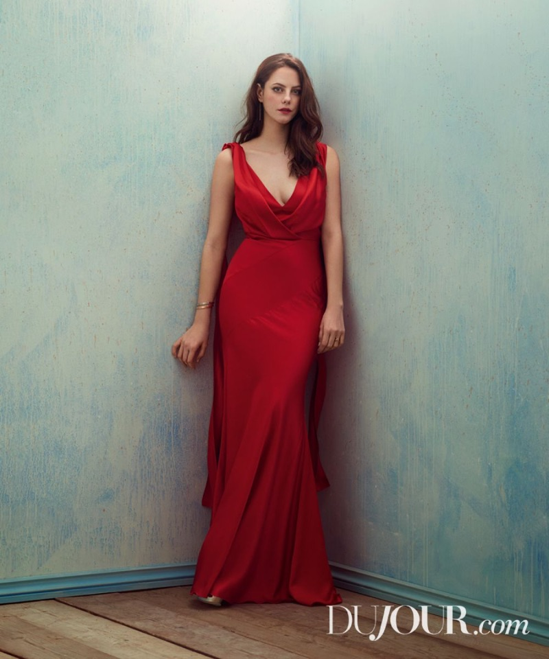 Dressed in red, Kaya Scodelario poses in sleeveless gown