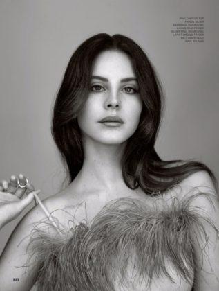 Getting her closeup, Lana Del Rey wears Prada pink chiffon top with feathers