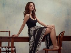 Kaya Scodelario flaunts some leg in a printed skirt and tank top look