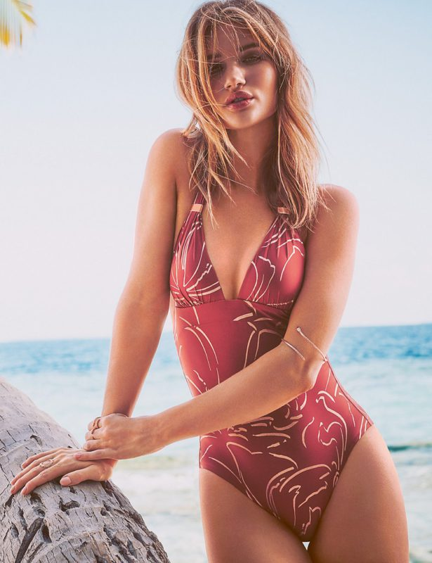 This push-up, halter-neck swimsuit features rose gold trim with a flattering v-neck and slim silhouette.