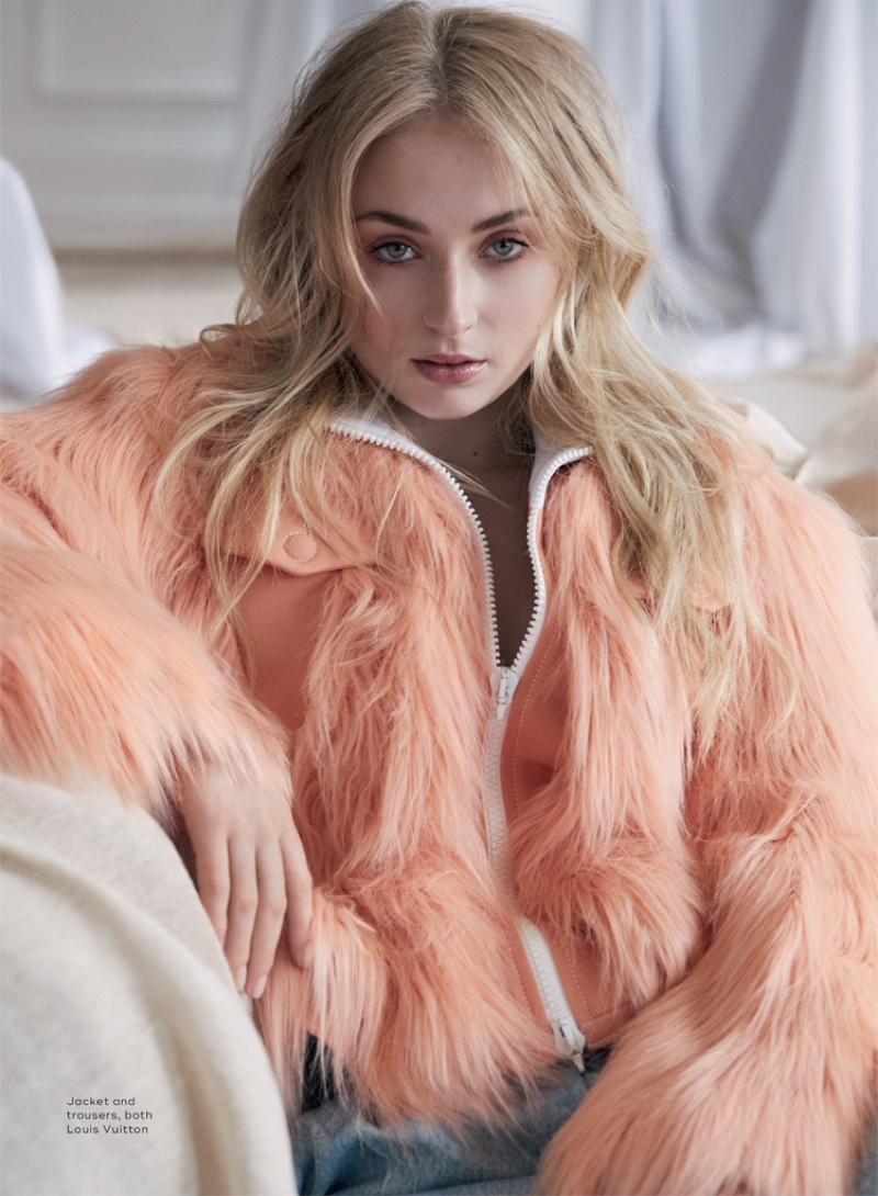 Sophie Turner poses in Louis Vuitton jacket and pants