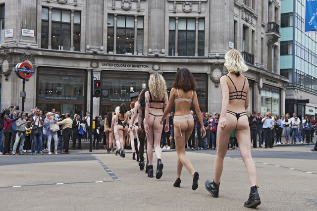 Bluebella Dare To Bare models departing Oxford Circus crossing as onlookers take pictures