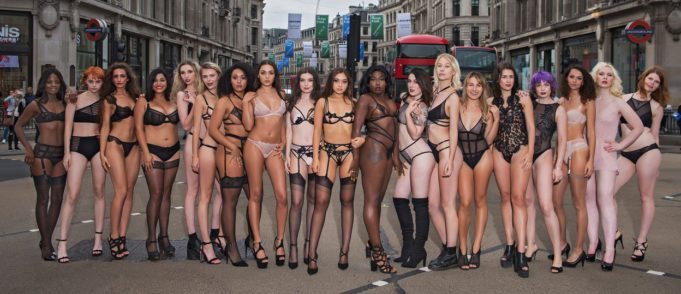 Instagram models walk through London City wearing nothing but lingerie