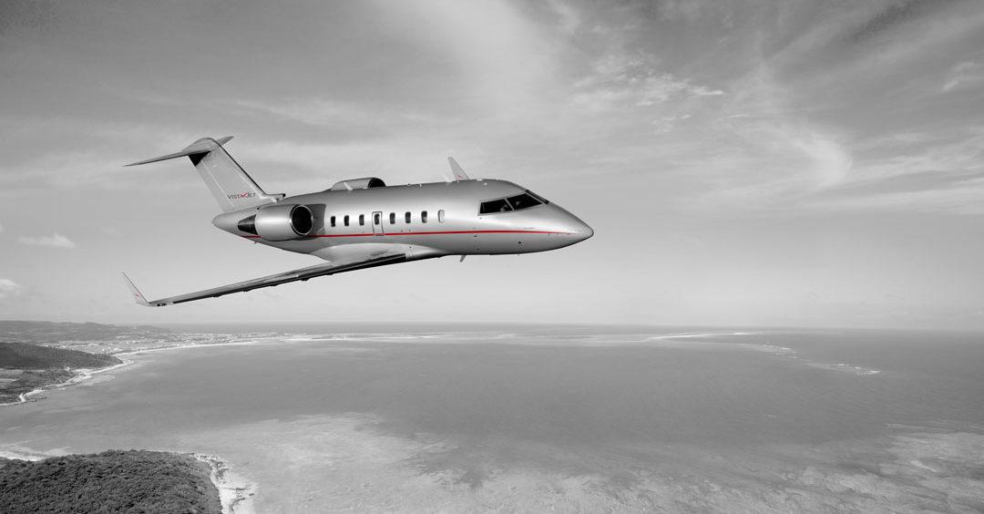 vistajet bombardier challenger 605-private-jet-in-flight