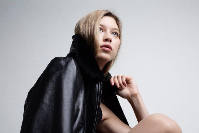 Choiss - women wearing black bomber jacket