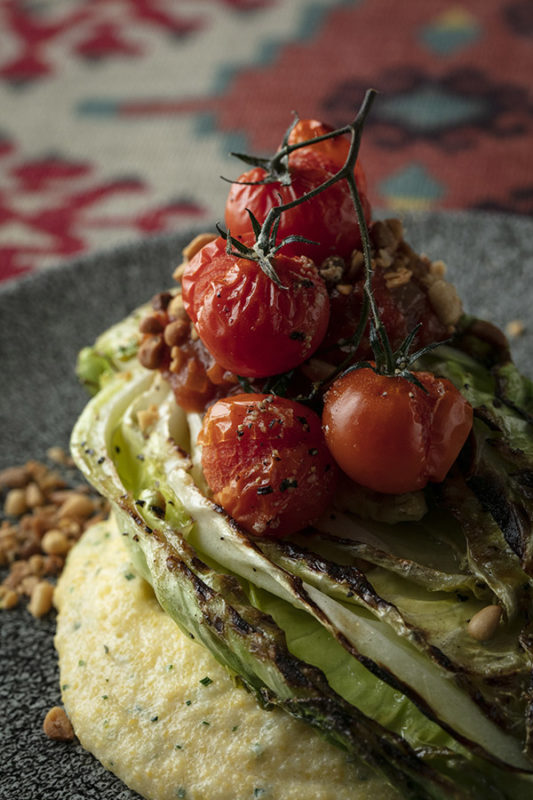 Grilled hispi cabbage, Stilton polenta, tomato relish, pinenuts