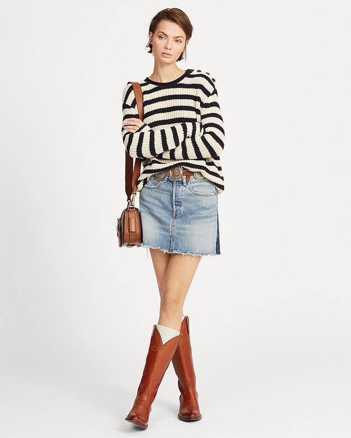 women wearing a denim skirt and boots
