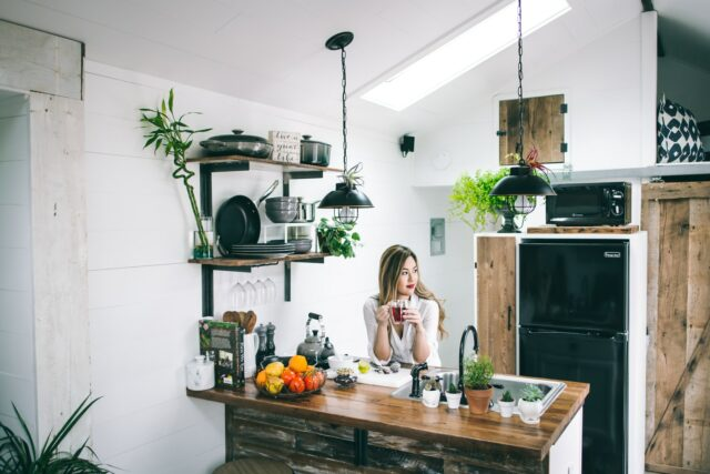 women sitting in the kitchen in a beautifully designed home