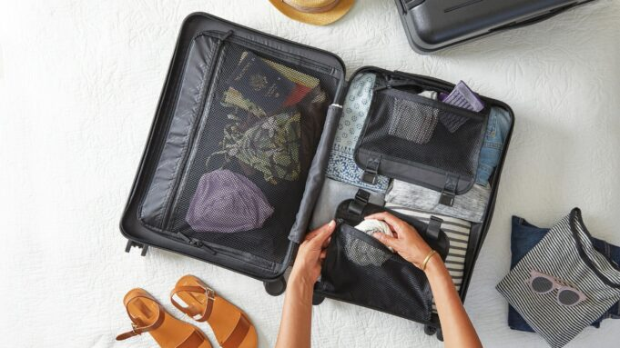 A suitcase and travel items being packed