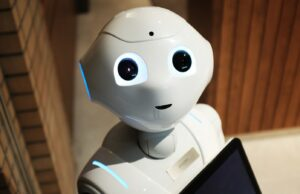 mini robot looking into a camera