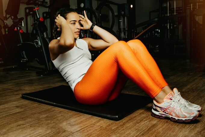 woman exercising on mat