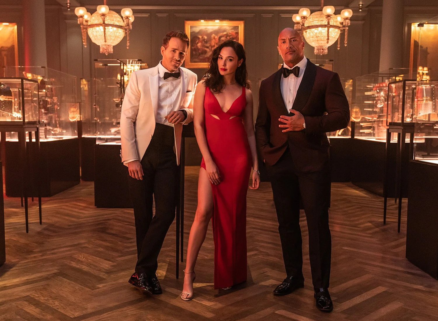 Ryan Reynolds, Gal Gadot and Dwayne Johnson posing for a photo for Red Notice
